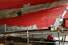 New hull plank being primed & painted
