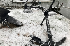 Anchors on the foreshore at Oulton Broad, Lowestoft, sprinkled in snow